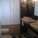 Bathroom, complete with bidet and chandeliers