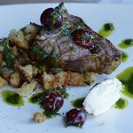 Perfect lamb chop on panzanella salad