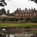 Lynford Hall Hotel from across the swan lake