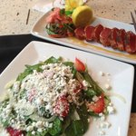 Happy Hour at Ruth's Chris! Goat cheese and spinach salad, and tuna happy hour app.