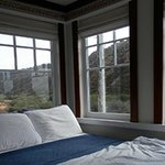 The bed in Flag - the pillows face more windows with a great harbor view.