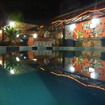 Pool / Restaurant / lounge area at night