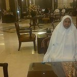 My mother and I waiting at the lobby for friends to go tawaf together. I am the one taking photo
