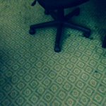 Stained carpet around desk