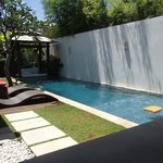 Rectangle narrow pool. Next to wall is security house.