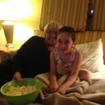 enjoying our popcorn on the sleepover with grammie