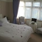 Lavender Bedroom showing pretty bed linen