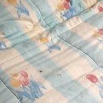 The stained bedspread on top of my bed