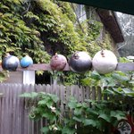 Ceramic hens perched on the fence