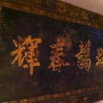 asian artwork over the bed
