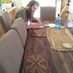 Writing in the guest book at the dining table