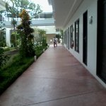 hallway from rooms to the pool area and resto