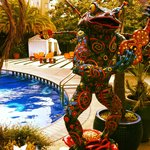 Guitar playing frog sculpture greets you at the pool