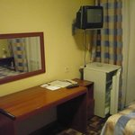 Room facilities - mirror, refrigerator, table , TV