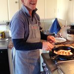 Our Host: Peter happily making breakfast !