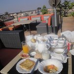 DELICIOUS breakfast served on the rooftop terrace