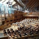 in the debating chamber of the Scottish Parliament