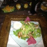Caesar salad with shrimp and goat cheese appetizer