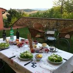 Dinner on patio: local produjce, cheeses, wines and prepared meats