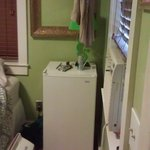 Mini-fridge and clothes rack