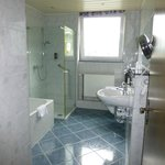 Extra large bath with separate bathtub and shower.