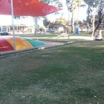 Large lawned area for the kids. Including jumping pillow, pool and play equipment.