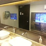 tvs in foyer bathrooms blasting out the tunes