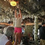 Young girl attaching her dollar bill to the ceiling
