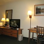AmericInn Lodge & Suites Cody: room with desk and TV