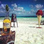 Enjoying a Corona by the beach in Tulum