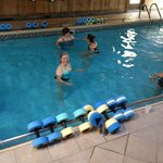 Pool Exercises included noodles and water weights