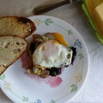fresh eggs from the hen house, chard an Potatoe from the garden and bread from the bakery