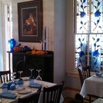 Second Dining Room With Blue Rose Stained Glass Window
