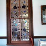 Rose Stained Glass Windows Seperate Both Dining Rooms