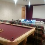 The theater and pool table in the basement