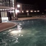 Indoor/Outdoor pool at night.