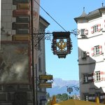 Hotel Goldener Adler on left with alps in background