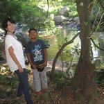 my son and my japanies friend near the natural pool  in the hotel