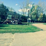 Playground and entrance to hiking trails at back of property.