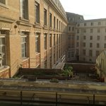 View from Room #31 - high school courtyard & greenhouse. People at greenhouse may impact privacy