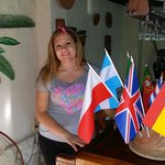 My lovely wife with all the flags as a sing of all the nationalities are welcome. ..