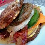 The Weekender: French toast, Sausage, avocado, bacon, one fried egg, and cheddar cheese