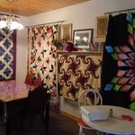 Interior of Louisa's Coffee House with quilts for sale
