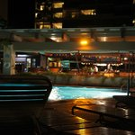 Nighttime view of the pool and restaurant
