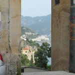 Amalfi seen through the gate of a building down the road
