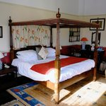 Four Poster Bed and Main Room in Garden Suite