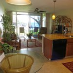 Living room & sliding door to Lanai/Patio - wonderful ocean view - unit 111