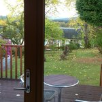 View ffrom Garden Room 2. Decking, garden and train station