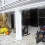 Lovely harvest style decorations on the front porch