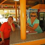Ladies working at the tiki bar and food kiosk